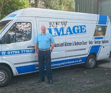 Andrew for New Image standing in front of the van